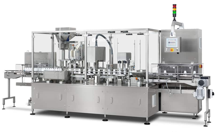 Capping machine with rake transport and desiccant insertion station
